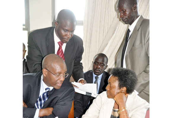 Flavia Waduwa ( seated R) chats with her mentor Pius Bigirimana
